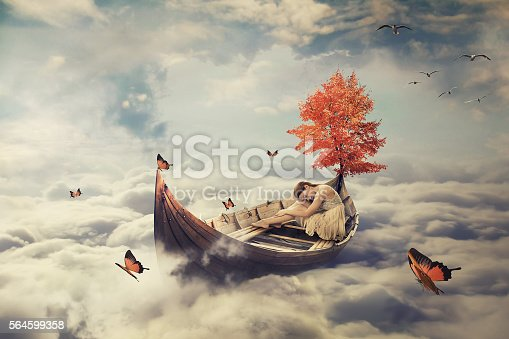istock Young lonely woman drifting on boat above clouds. Dreamy screensaver 564599358