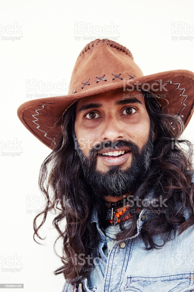7303e350b06 Young long haired asian man portrait wearing cowboy hat royalty-free stock  photo