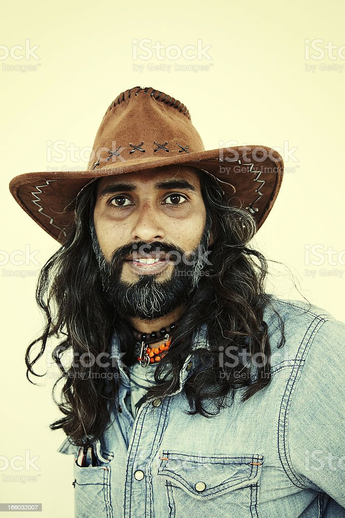 Young long haired asian man portrait wearing cowboy hat royalty-free stock photo