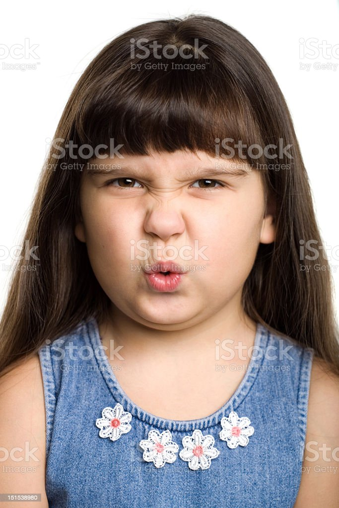 Young long-haired brunette girl, making a sour face royalty-free stock photo