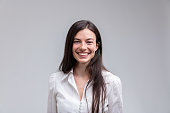 Young long-haired smiling woman in white shirt