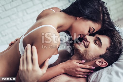istock Young love couple in bed 956368738