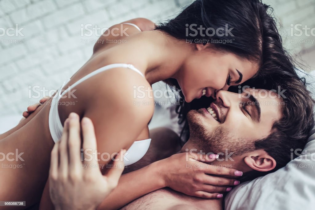 Young love couple in bed stock photo