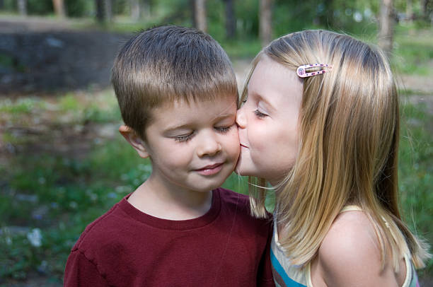 young love - little girls little boys kissing love stock photos and pictures