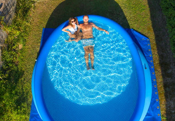 Young lovely couple relaxing in a swimming pool stock photo