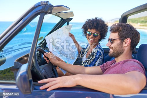 istock Young lovely couple using  map during roadtrip 509545148