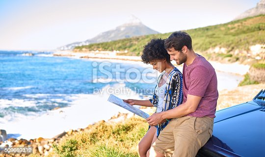 istock Young lovely couple using  map during roadtrip 509669312