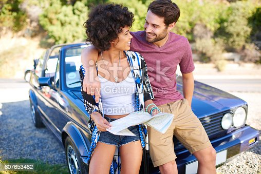 istock Young lovely couple using  map during roadtrip 607653462