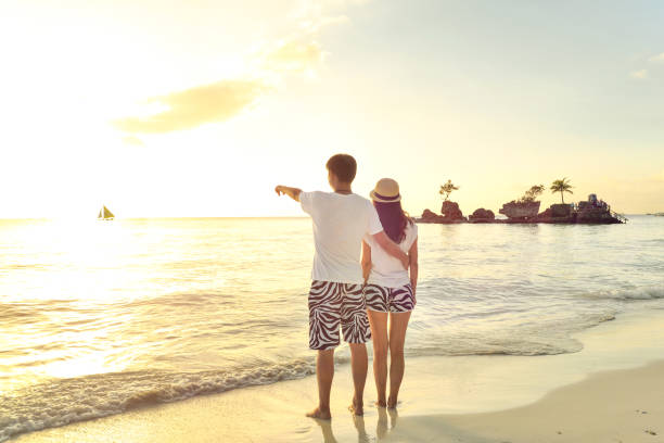 young lovers on boracay beach - philippines girl stock photos and pictures