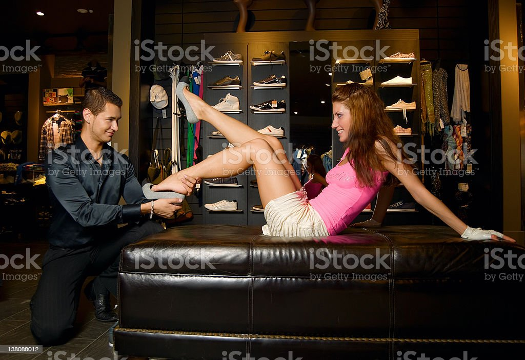 Young lovers wearing new shoes. stock photo