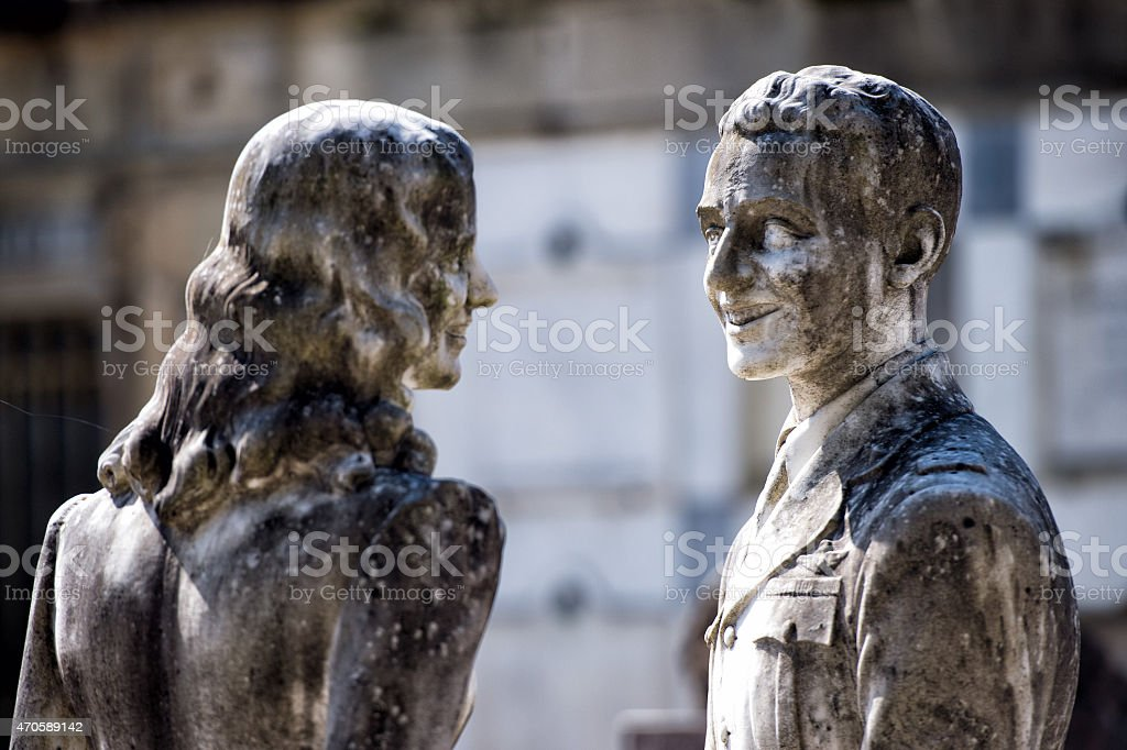 young lovers while smiling marble statue stock photo