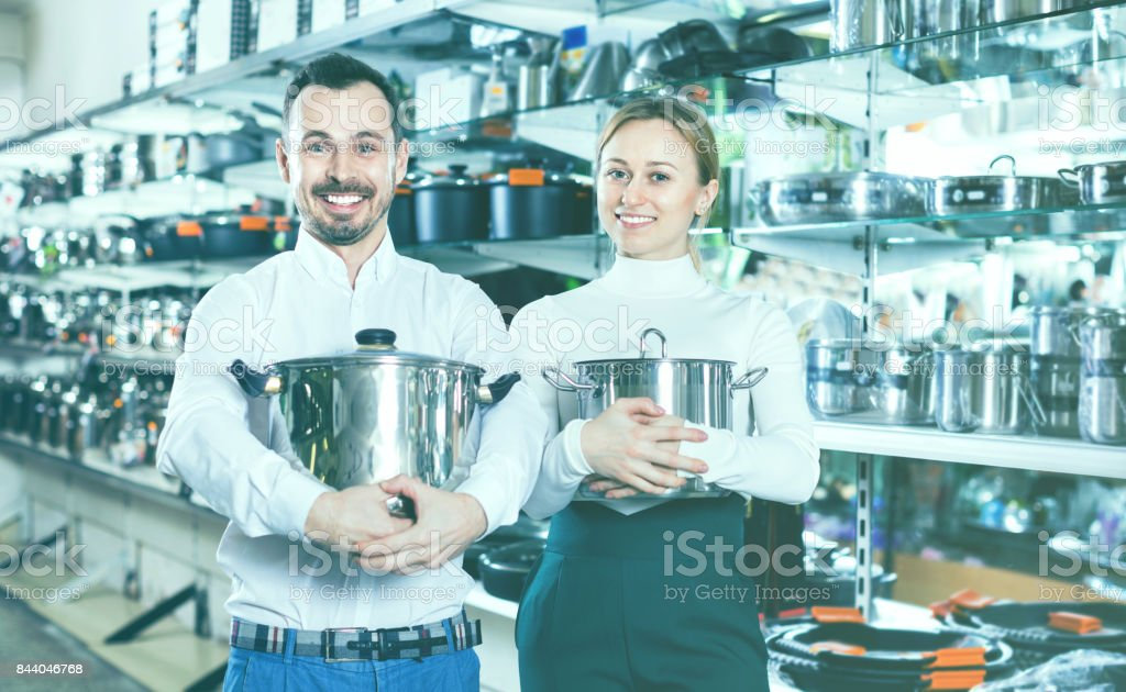 Young loving couple enjoying their purchases stock photo