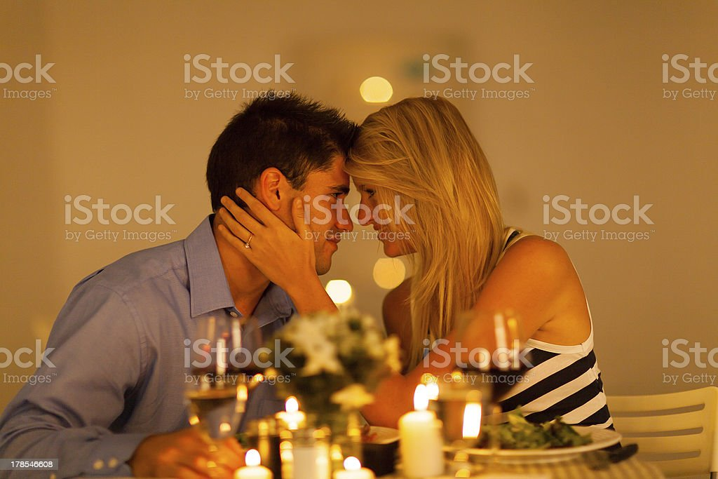 young loving couple having romantic dinner stock photo
