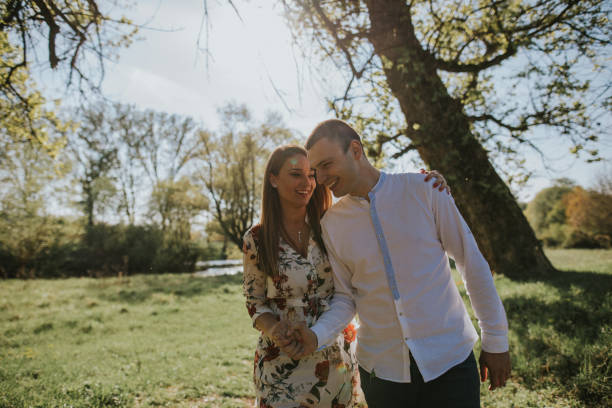 young loving couple in the park - dtephoto stock photos and pictures