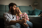 Young loving couple relaxing in the living room.