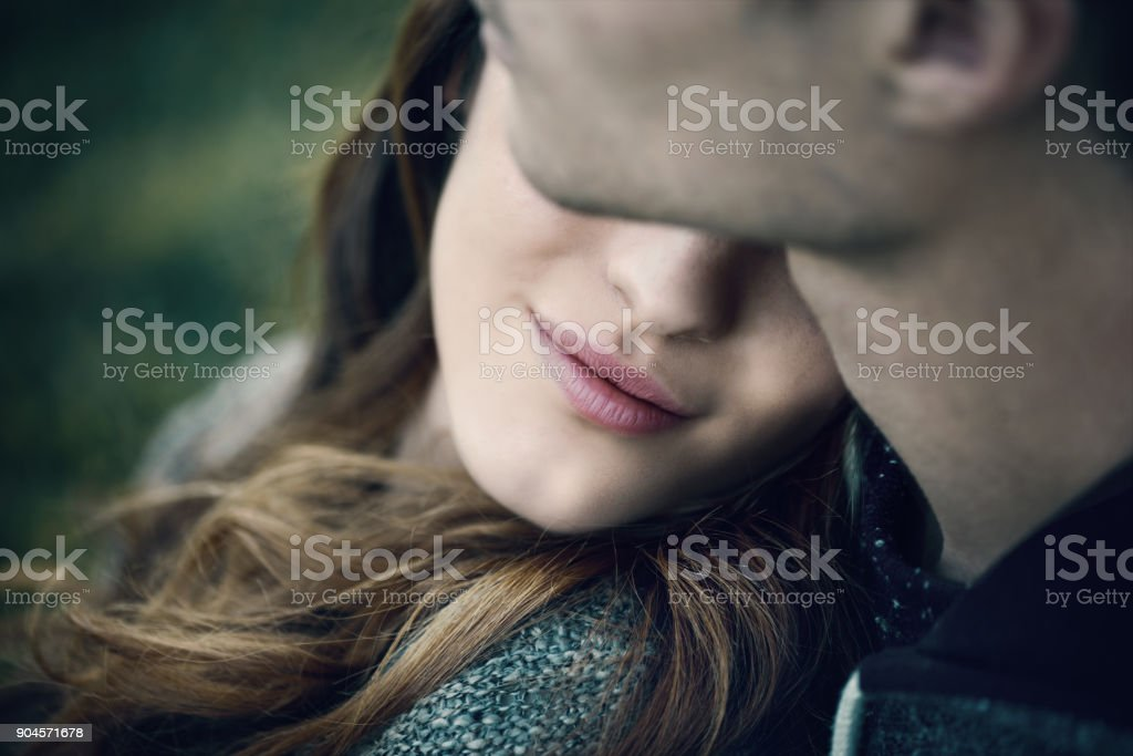 Young loving couple relaxing on the grass stock photo