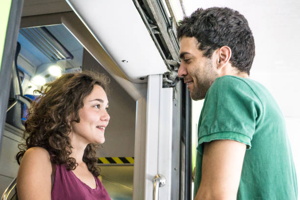 a young loving couple saying goodbye at the train station - konduktor pociągu zdjęcia i obrazy z banku zdjęć
