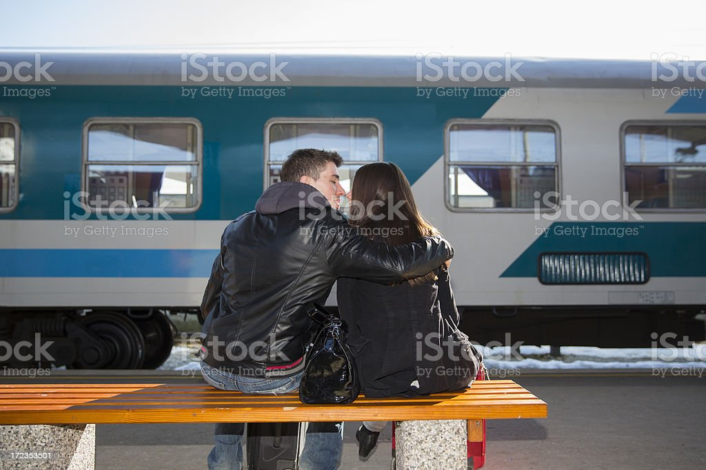 Young loving couple waiting for a train royalty-free stock photo