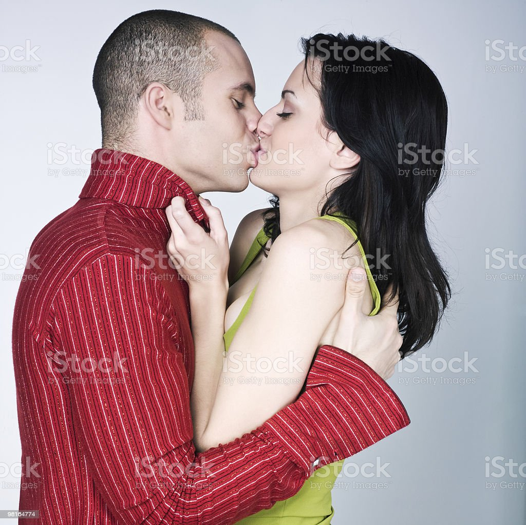 young loving kissing couple passion royalty-free stock photo