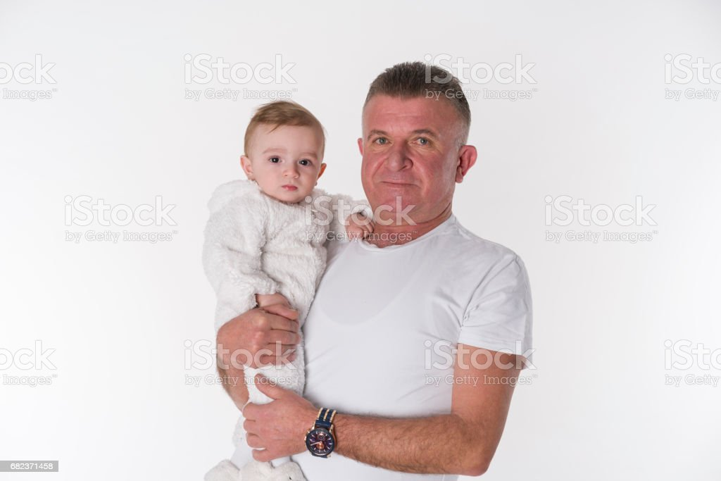 Young loving parents holding their 7 month old baby foto stock royalty-free