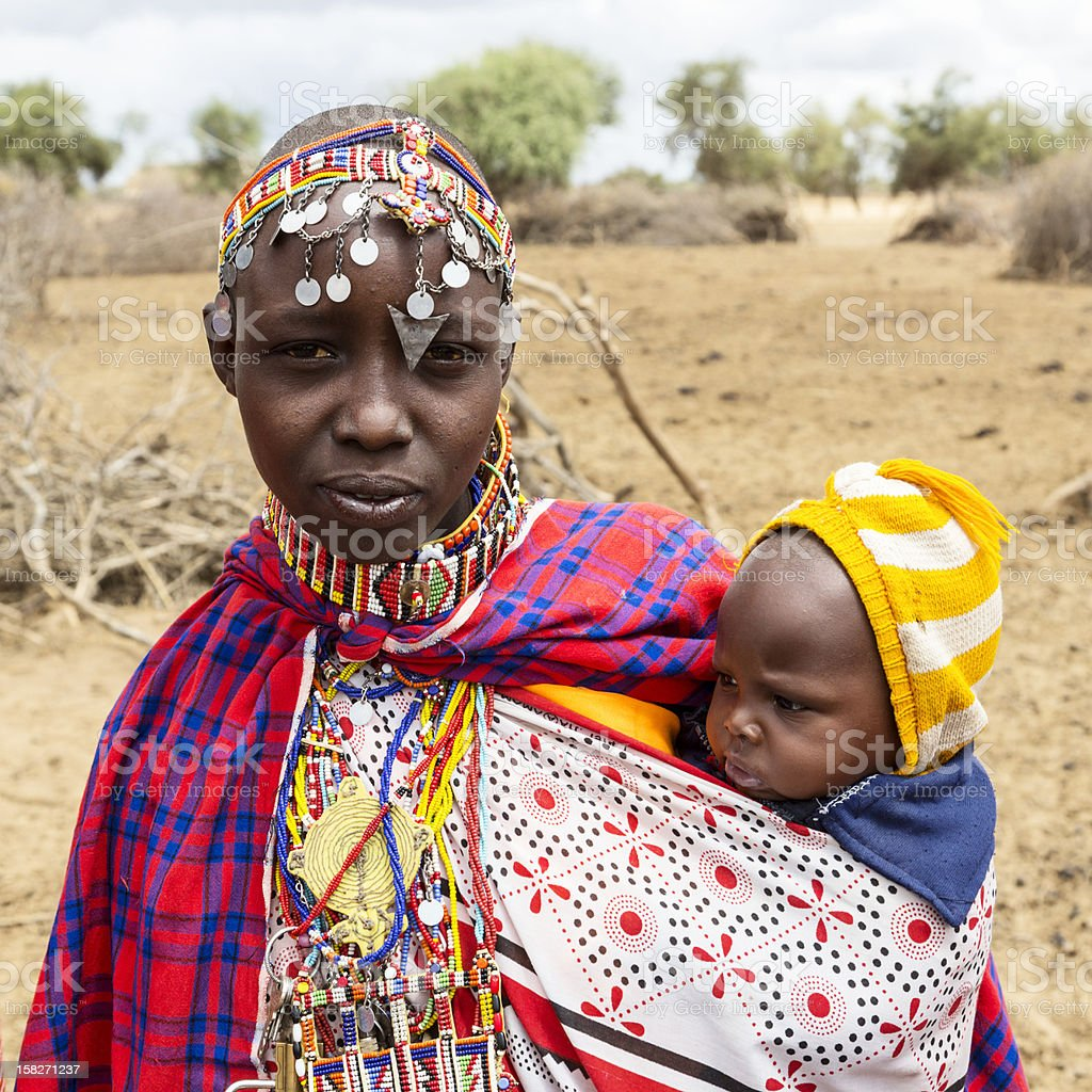 Young Maasai mother with baby. stock photo
