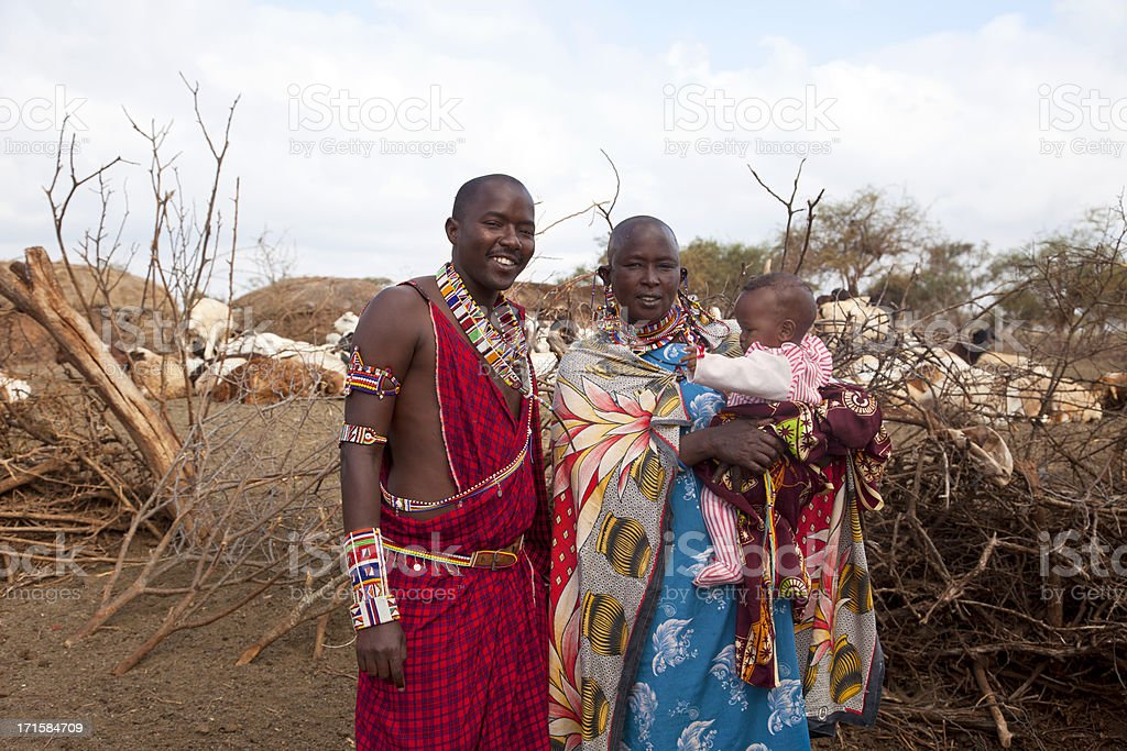 Young maasai warrior with baby and mother stock photo