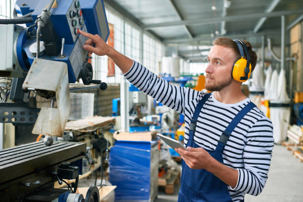 young machine operator at modern plant - switchboard operator stock photos and pictures