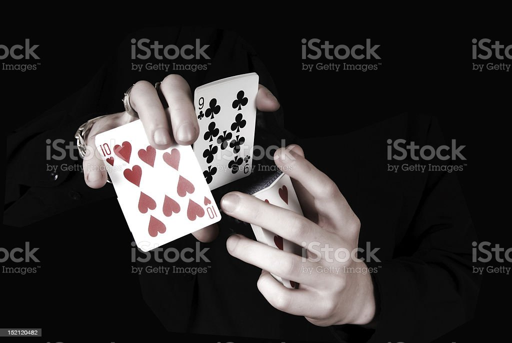 Young magicians hands holding a lot of play cards stock photo