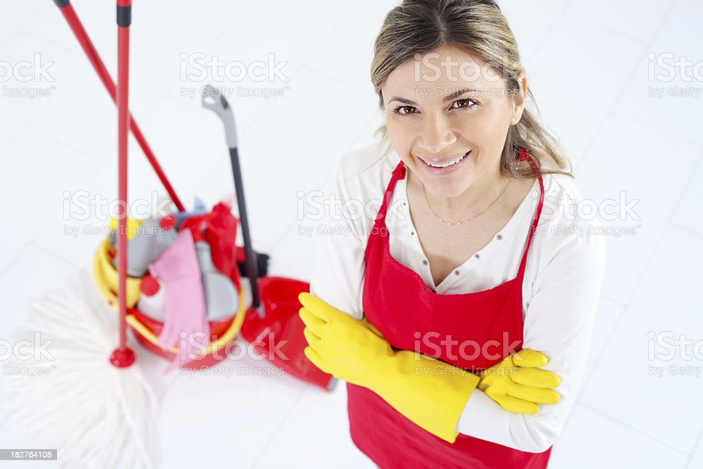 Young maid with crossed arms looking at camera. stock photo