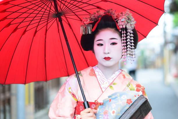 young maiko in kyoto - geisha girl stock photos and pictures