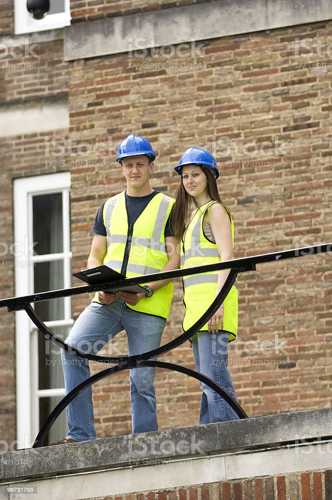 Young male and female construction engineers view a site royalty-free stock photo