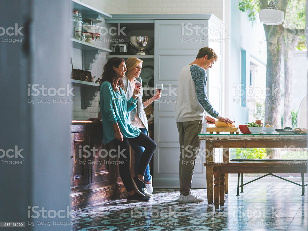 Young male and female friends socializing at home stock photo