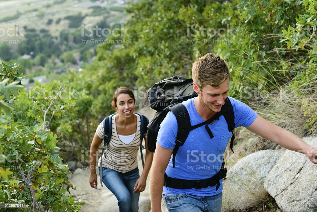 Young Male and Female Hiking on a Trail stock photo