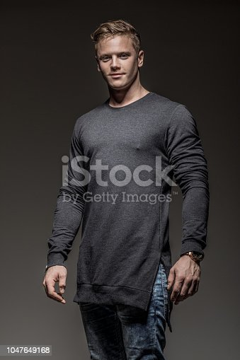 Handsome casual young male athlete in studio shot