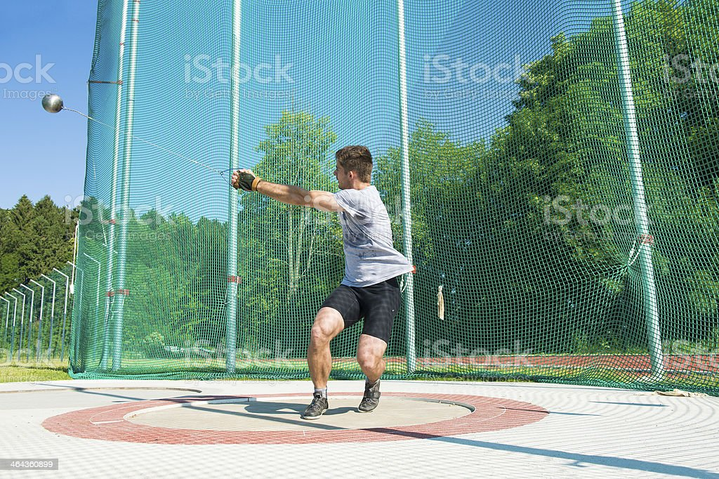 Young male athlete throwing the hammer royalty-free stock photo