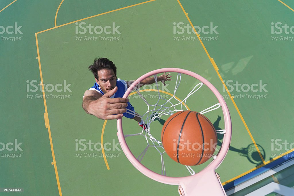 Young Male Basketball Player Making a Basket stock photo