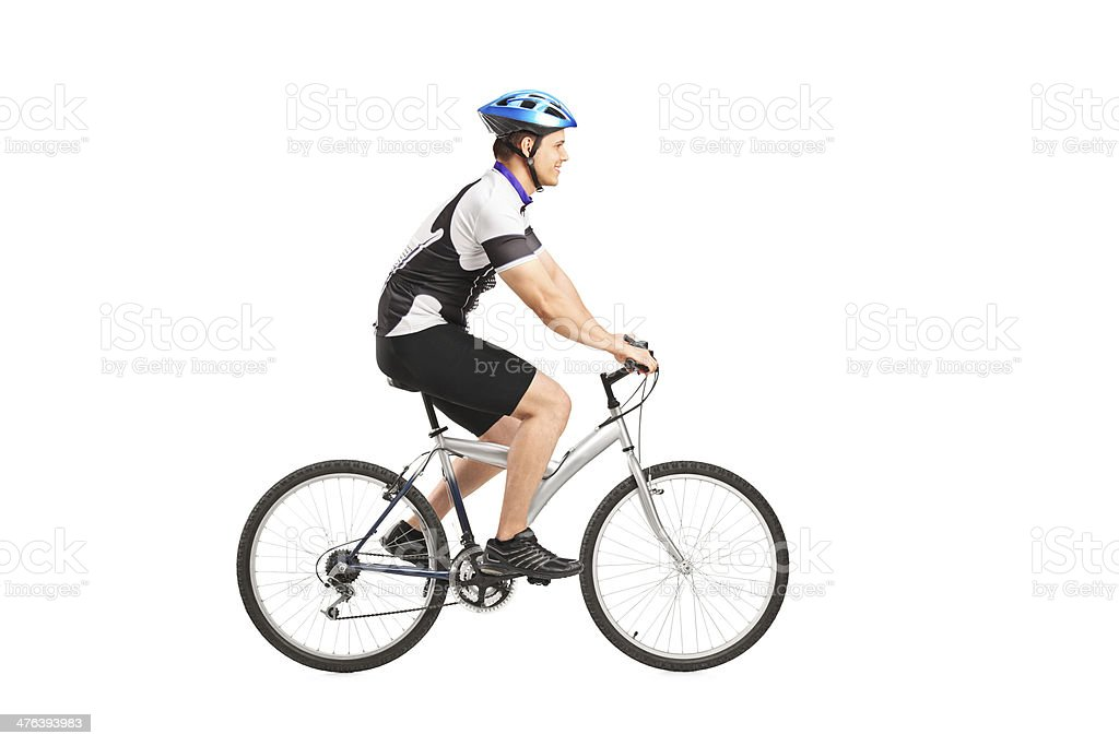 Young male bicyclist riding a bicycle royalty-free stock photo