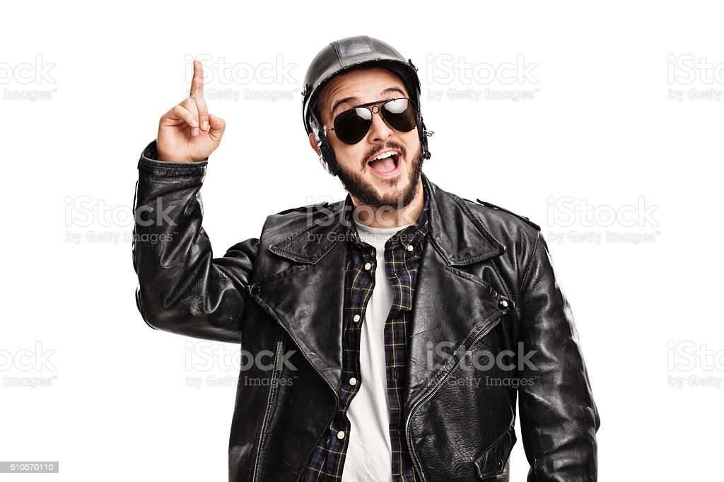 Young male biker having an idea stock photo