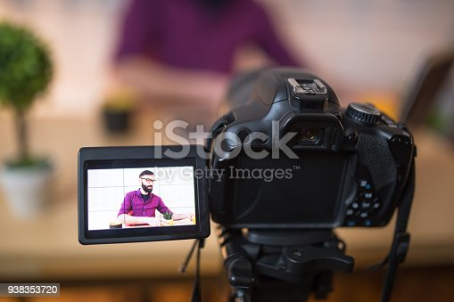 1179265329 istock photo Young male blogger recording video at home 938353720