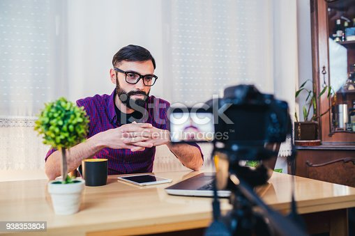 1179265329 istock photo Young male blogger recording video at home 938353804