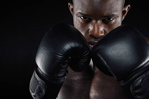 Young male boxer in a fighting stance stock photo