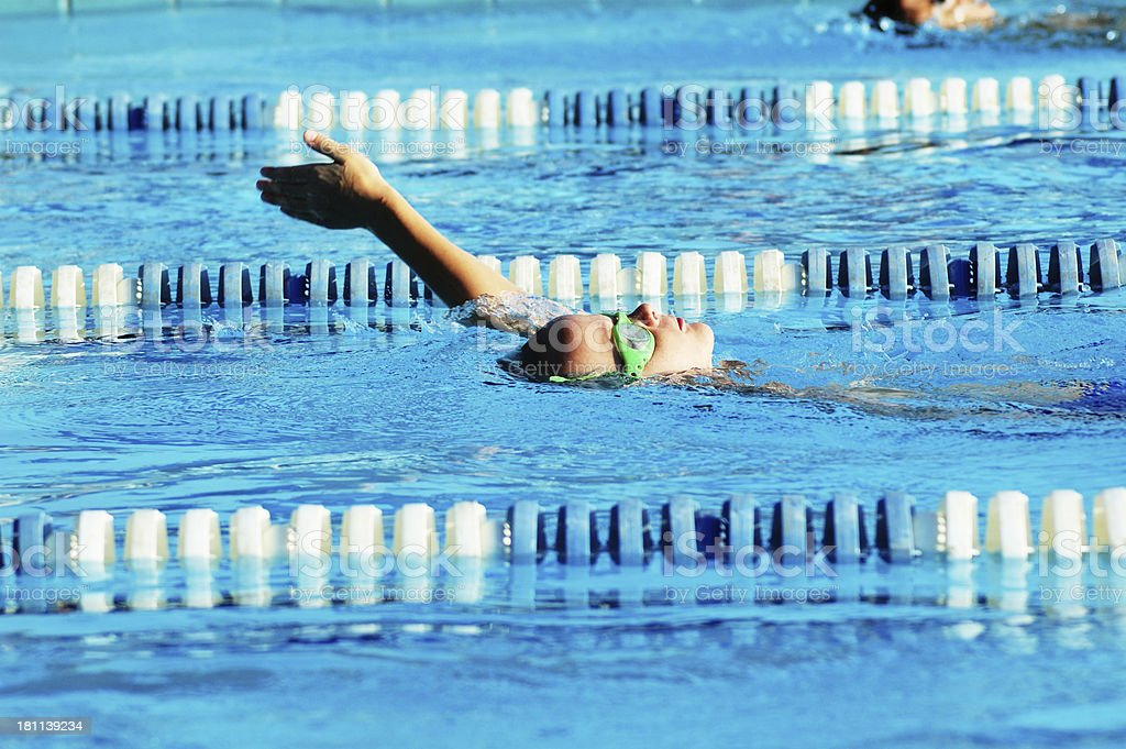 Young Male Boy Backstroke Swimming Race stock photo