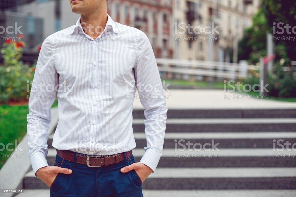 Young male businessman in shirt and blue pants. stock photo