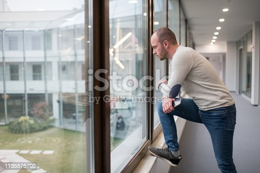 626916886istockphoto Young male businessman thinking outside his office 1135575702