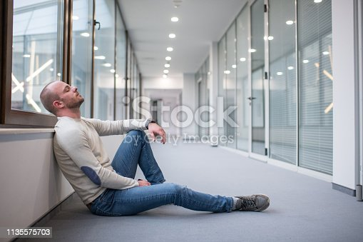 626916886istockphoto Young male businessman thinking outside his office 1135575703