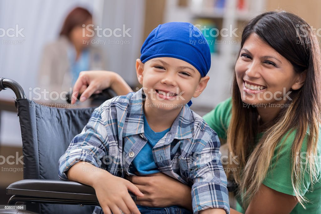 Young male cancer patient waits in waiting room stock photo
