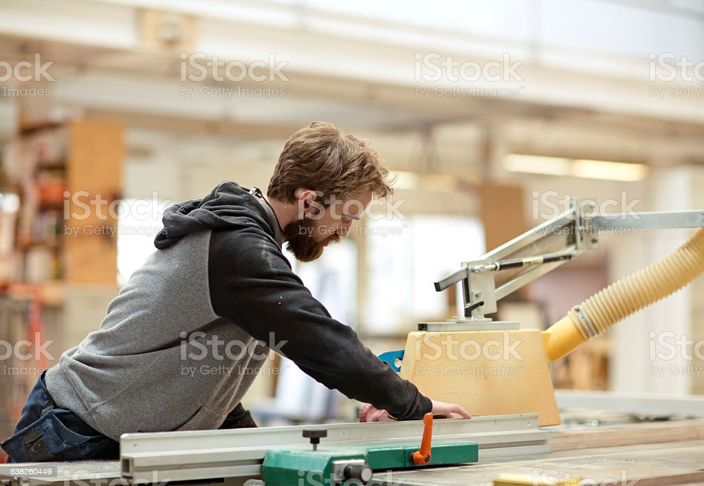 Young male carpenter at work stock photo
