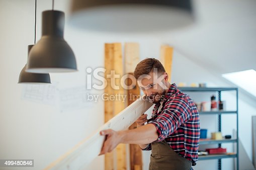 istock Young Male carpenter Checking Plank Surface. 499480846