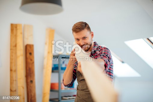 istock Young Male carpenter Checking Plank Surface. 514742206