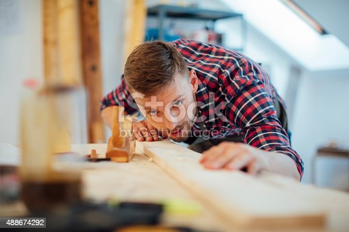 istock Young Male carpenter working on a project in his workshop. 488674292